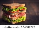 delicious sandwich with  ham ... | Shutterstock . vector #564884272