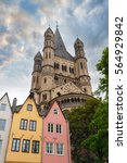 Small photo of Great St. Martin Church and colorful houses in Bavarian style of Cologne. Cologne, North Rhine-Westphalia, Germany.