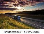 truck transportation at sunset | Shutterstock . vector #564978088