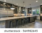 Stock photo modern kitchen with brown kitchen cabinets oversized kitchen island with bar stools granite 564982645
