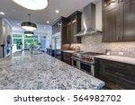 modern kitchen with brown... | Shutterstock . vector #564982702