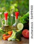 Oil, vinegar and vegetables. - stock photo