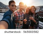 young friends partying together ... | Shutterstock . vector #565003582