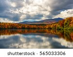 Small photo of Reflective Price Lake in the Fall Blue Ridge Mountains, Appalachian Mountains, North Carolina