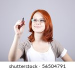 Young businesswomen with pen in hand - stock photo