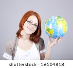 Young businesswomen with globe - stock photo