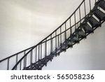 a black wrought iron spiral... | Shutterstock . vector #565058236