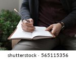 taking notes in journal | Shutterstock . vector #565115356