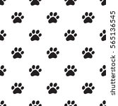 seamless dog paw pattern on... | Shutterstock .eps vector #565136545
