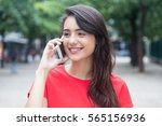 beautiful girl with red shirt... | Shutterstock . vector #565156936