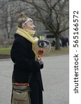"""Small photo of TORONTO - JANUARY 21: A woman showing sign where it is being asked to """"wake up and speak up against issues during the """"Women's March on Washington"""" on January 21, 2017 in Toronto, Canada."""