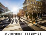 Stock photo crowd of anonymous people walking on busy city street 565189495