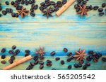 coffee beans  cinnamon sticks... | Shutterstock . vector #565205542