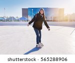 young and pretty girl skating... | Shutterstock . vector #565288906
