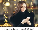 beautiful young woman city... | Shutterstock . vector #565295962