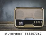 old retro radio with on table... | Shutterstock . vector #565307362