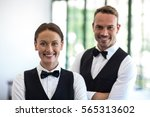 waiting staff smiling at camera ...   Shutterstock . vector #565313602