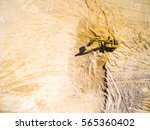 aerial view of a working... | Shutterstock . vector #565360402