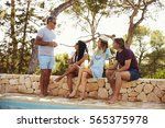 two adult couples socialising... | Shutterstock . vector #565375978