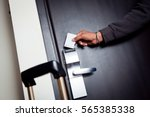Stock photo young indian man unlocking his hotel room 565385338