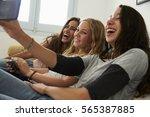 teenage girl taking selfie with ... | Shutterstock . vector #565387885
