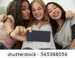 three teenage girls taking... | Shutterstock . vector #565388056