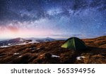 the starry sky above the tent... | Shutterstock . vector #565394956