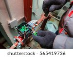 mechanical engineer installs... | Shutterstock . vector #565419736
