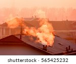 the smoke from the chimneys on... | Shutterstock . vector #565425232