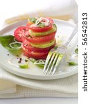 Appetizer from tomatoes and zucchini with onion and olive oil - stock photo