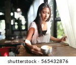 woman in coffee shop with a cup ... | Shutterstock . vector #565432876