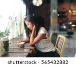 woman in coffee shop with a cup ... | Shutterstock . vector #565432882