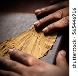 Small photo of Extreme close ups of a craftsmen hands rolling and cutting tobacco leaves in real ambiance