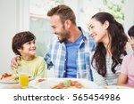 smiling parents looking at son... | Shutterstock . vector #565454986