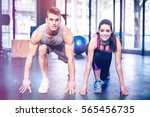 athletic couple stretching at... | Shutterstock . vector #565456735