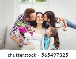 father and daughter kissing... | Shutterstock . vector #565497325