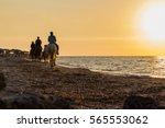 A Horseback Riders At The Beac...