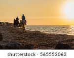 a horseback riders at the beach ... | Shutterstock . vector #565553062