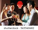 couples holding drinks  toasting | Shutterstock . vector #565560682