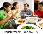 family having dinner at home | Shutterstock . vector #565562272