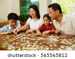 family playing jigsaw puzzle in ...   Shutterstock . vector #565565812