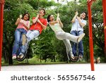 young adults in playground ... | Shutterstock . vector #565567546