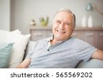portrait of happy senior man... | Shutterstock . vector #565569202