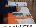 an old lady preparing her tax.  | Shutterstock . vector #565574332