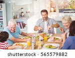 happy family having breakfast... | Shutterstock . vector #565579882