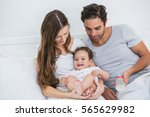 young couple relaxing with baby ... | Shutterstock . vector #565629982