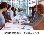 Small photo of Focused business people looking at screen during video conference in office