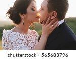 beautiful bride and groom... | Shutterstock . vector #565683796
