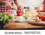 mother and daughter preparing... | Shutterstock . vector #565705732