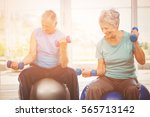 smiling senior couple holding... | Shutterstock . vector #565713142
